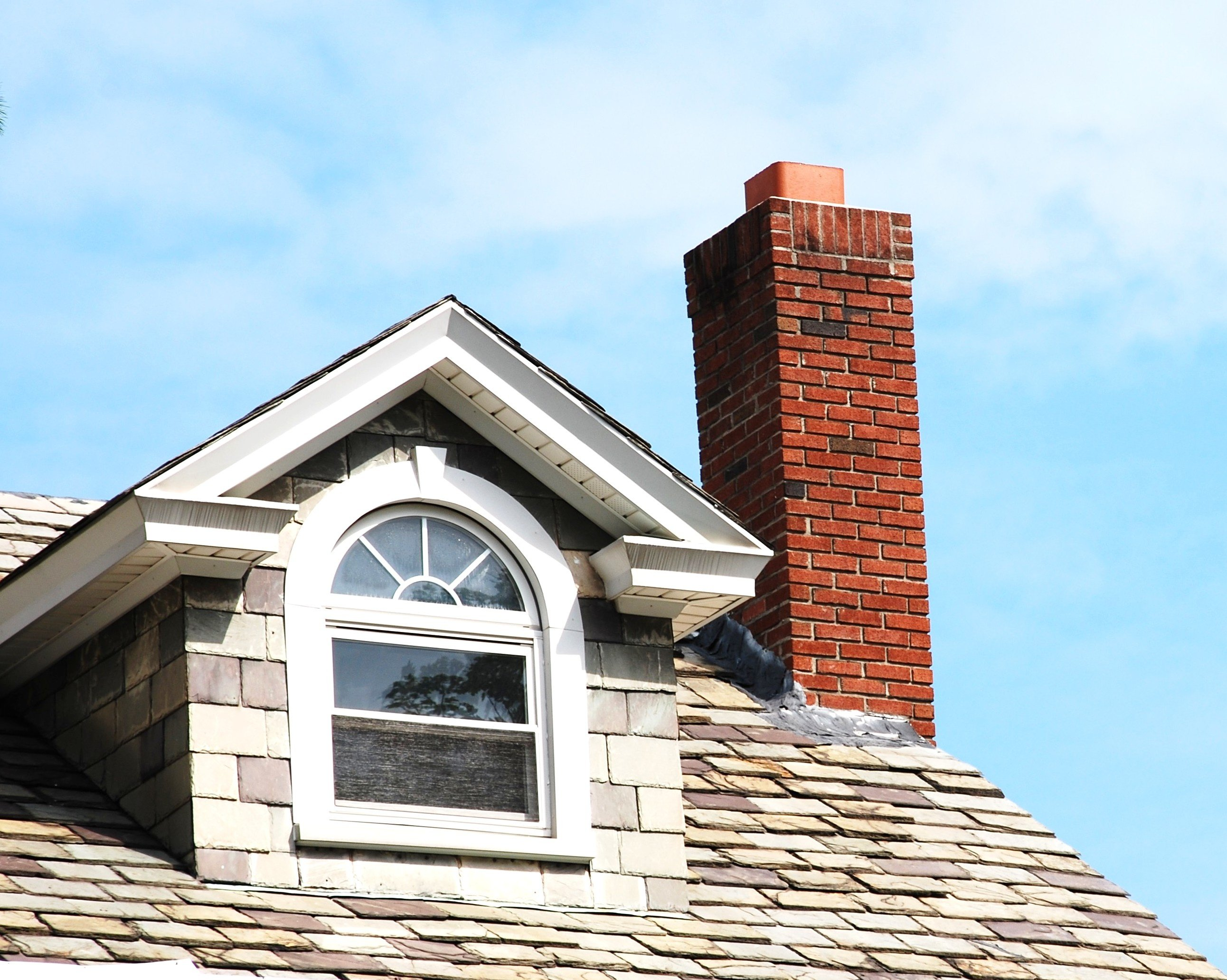 roof with a chimney missing a chimney cap